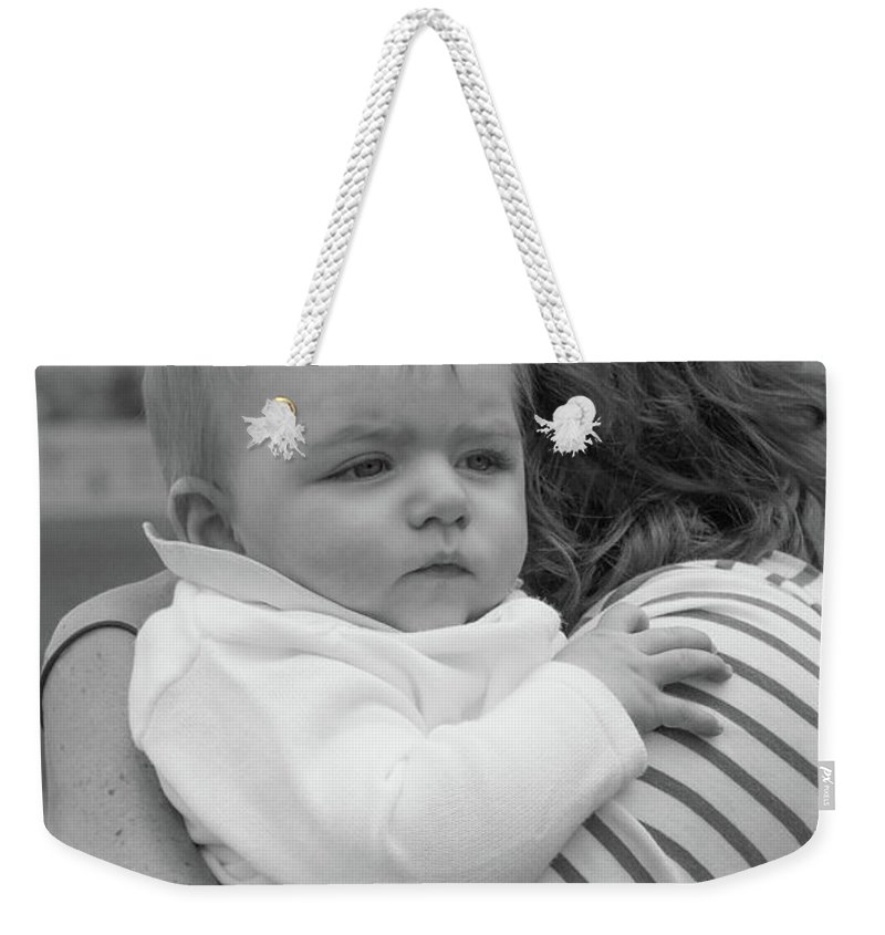 Artisans Weekender Tote Bag featuring the photograph Baby Content On Mom's Shoulder by Cary Leppert