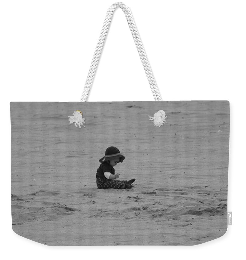 Black And White Weekender Tote Bag featuring the photograph Baby In The Sand by Rob Hans