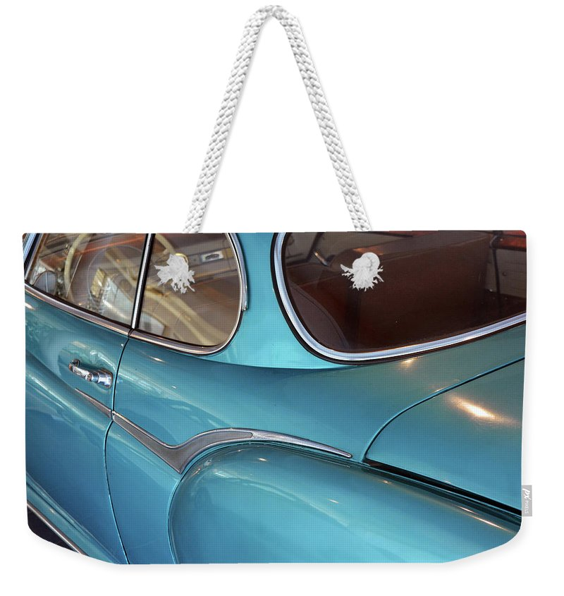 Old Weekender Tote Bag featuring the photograph Back Side Of A Blue Vintage Car by Oana Unciuleanu