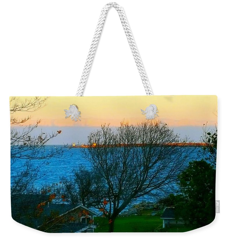 Blue Ocean Water Weekender Tote Bag featuring the photograph Backyard View In Autumn by Harriet Harding