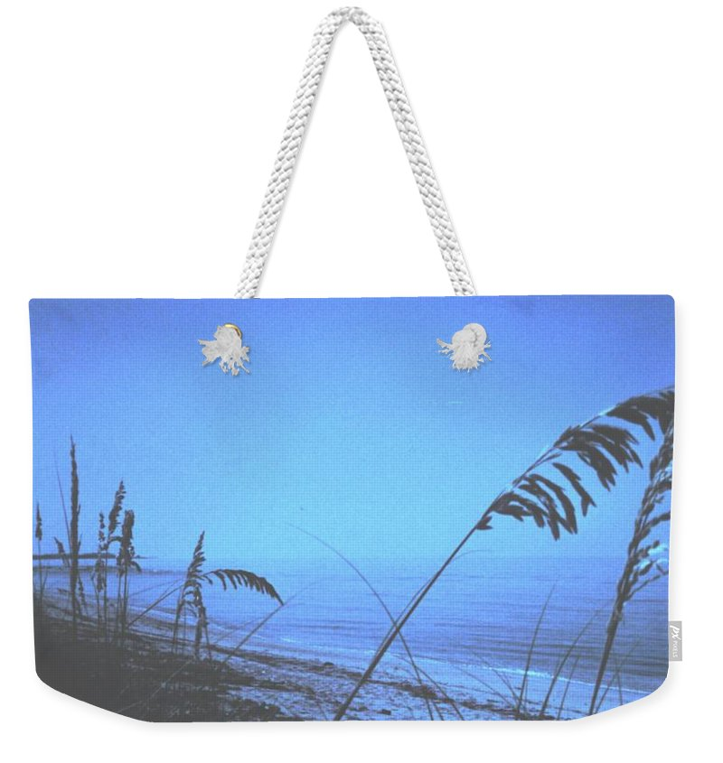 Weekender Tote Bag featuring the photograph Bahama Blue by Ian MacDonald