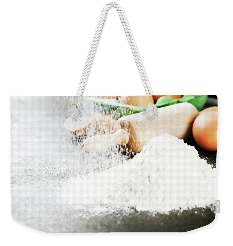 Bake Weekender Tote Bag featuring the photograph Baking Background by Natalia Klenova