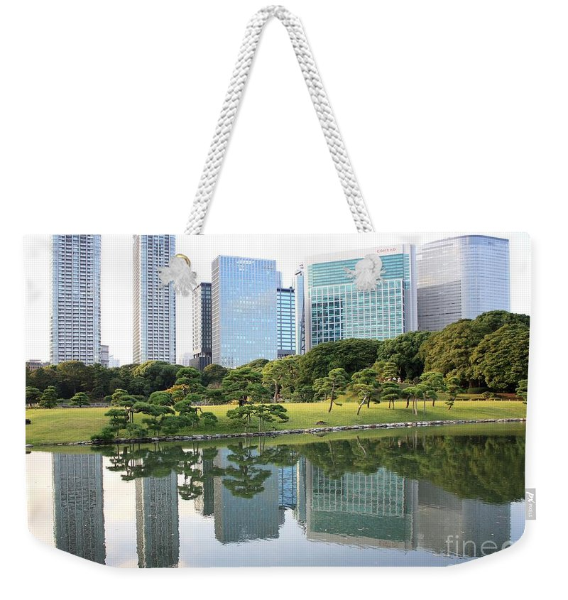Tokyo Weekender Tote Bag featuring the photograph Balance In Tokyo by Carol Groenen