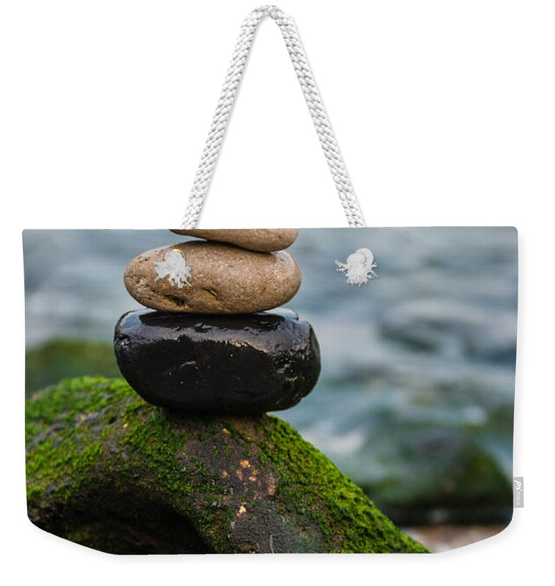 Zen Stones Weekender Tote Bag featuring the photograph Balancing Zen Stones By The Sea IIi by Marco Oliveira