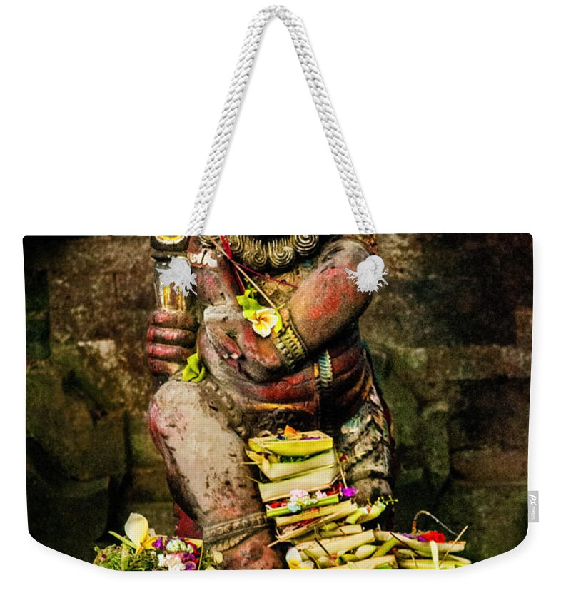 Bali Weekender Tote Bag featuring the photograph Balinese Hindu God by Lee Craker