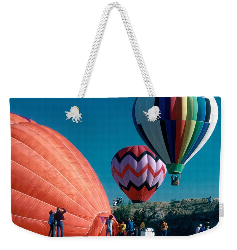 Hot Air Balloon Weekender Tote Bag featuring the photograph Ballon Launch by Jerry McElroy