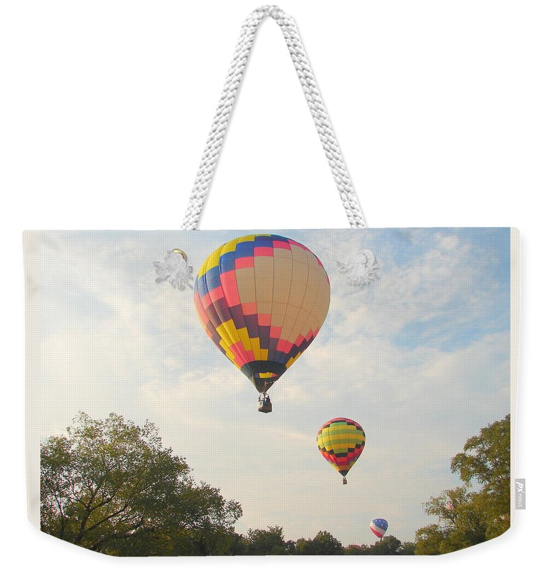 Weekender Tote Bag featuring the photograph Balloon Race by Luciana Seymour