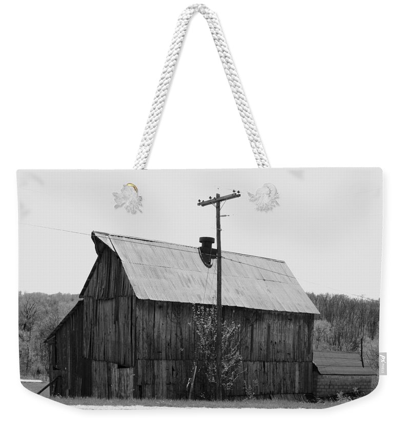 Barns Weekender Tote Bag featuring the photograph Barn On The Side Of The Road by Angus Hooper Iii