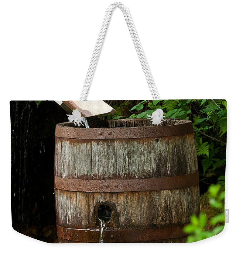 waterville Valley Weekender Tote Bag featuring the photograph Barrel Of Water by Paul Mangold