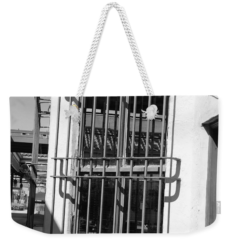 Train Station Weekender Tote Bag featuring the photograph Bars by Rob Hans