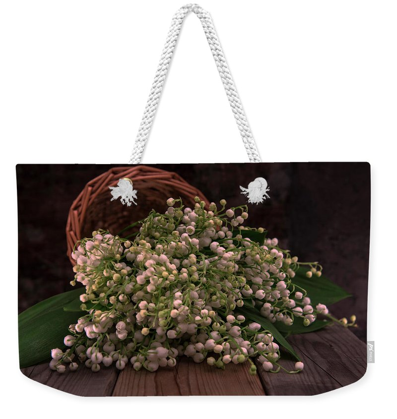 Basket Weekender Tote Bag featuring the photograph Basket Of Fresh Lily Of The Valley Flowers by Jaroslaw Blaminsky