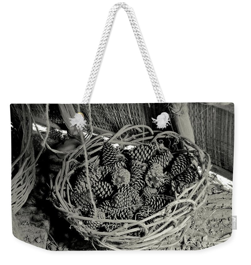 Nature Weekender Tote Bag featuring the photograph Basket Of Pine Cones by Peg urban