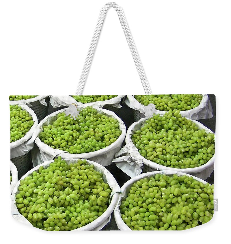 Thialand Weekender Tote Bag featuring the photograph Baskets Of White Grapes by Douglas Barnett