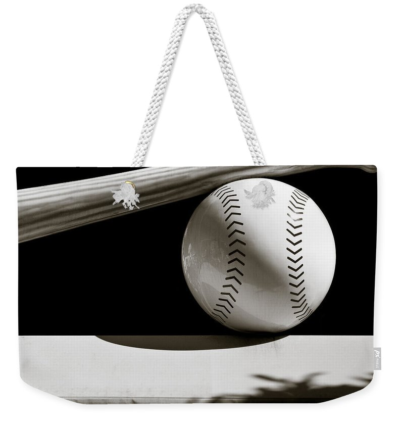 Baseball Weekender Tote Bag featuring the photograph Bat And Ball by Dave Bowman