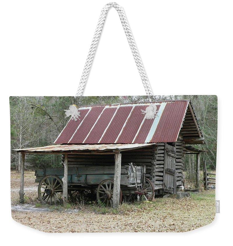 Barn Weekender Tote Bag featuring the photograph Battered Barn And Weathered Wagon by Al Powell Photography USA