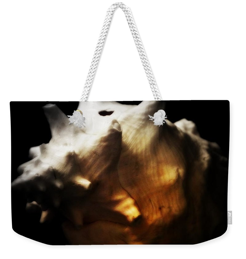 Digital Photograph Weekender Tote Bag featuring the photograph Battered Conch by Laurie Pike