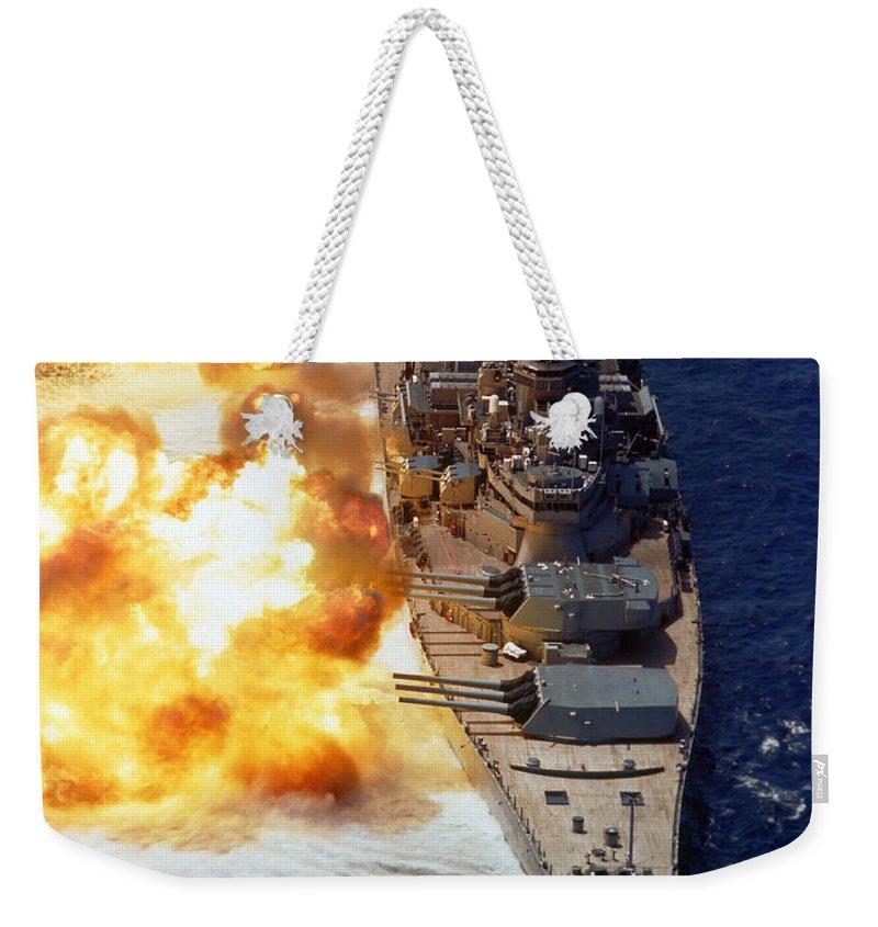 Vertical Weekender Tote Bag featuring the photograph Battleship Uss Iowa Firing Its Mark 7 by Stocktrek Images