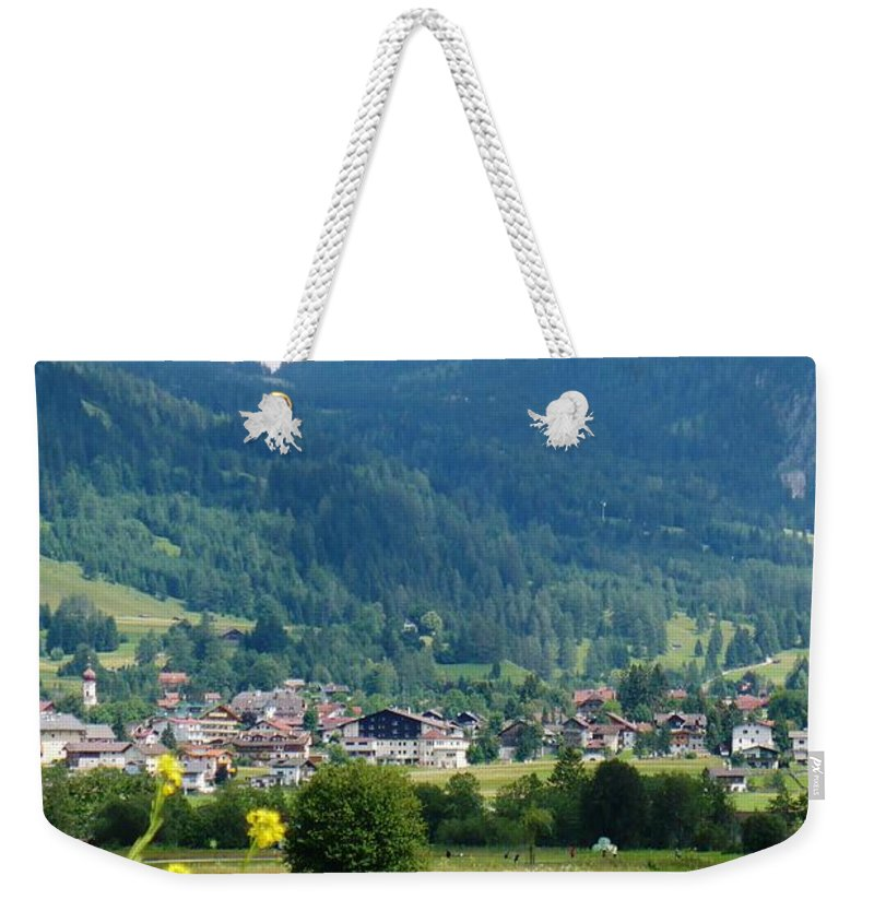 Bavaria Weekender Tote Bag featuring the photograph Bavarian Alps With Village And Flowers by Carol Groenen
