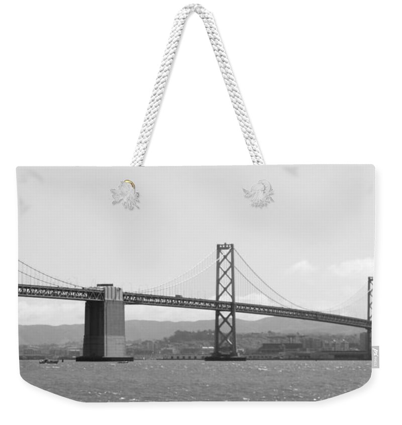 San Francisco Weekender Tote Bag featuring the photograph Bay Bridge In Black And White by Carol Groenen