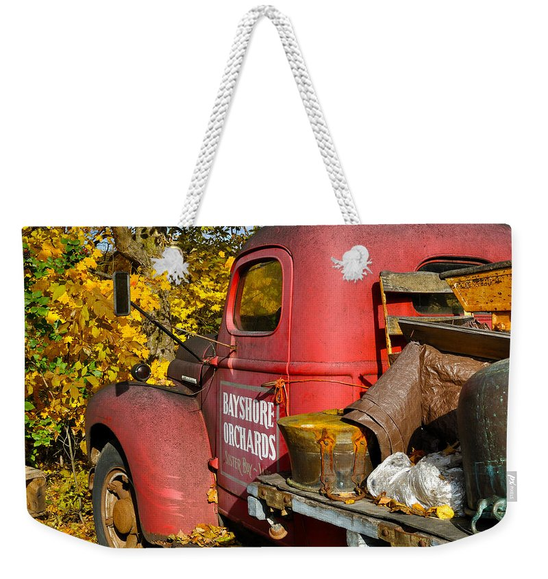Truck Weekender Tote Bag featuring the photograph Bayshore Orchards by Tim Nyberg