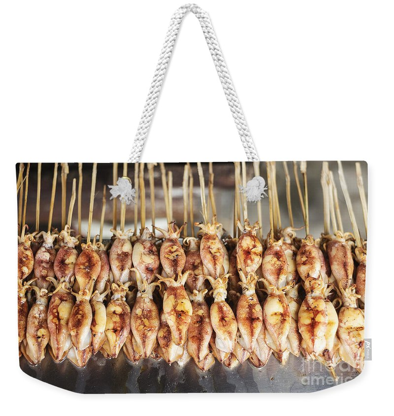 Asia Weekender Tote Bag featuring the photograph Bbq Asian Grilled Squid In Kep Market Cambodia by Jacek Malipan
