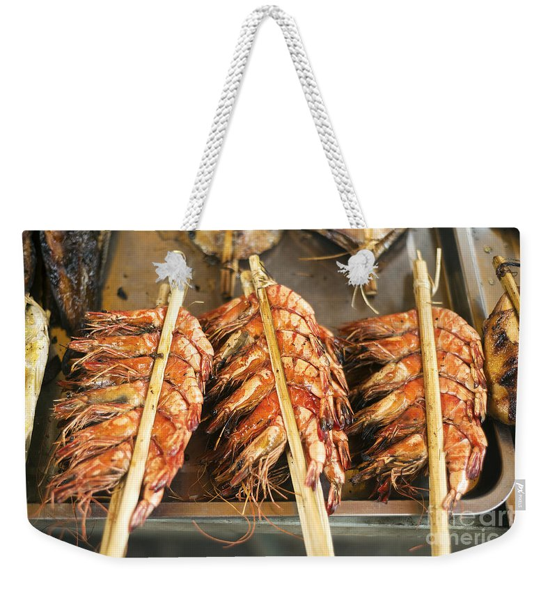 Asia Weekender Tote Bag featuring the photograph Bbq Fresh Grilled Prawns In Kep Market Cambodia by Jacek Malipan