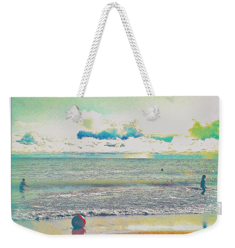Beach Weekender Tote Bag featuring the photograph Beach Ball And Swimmers by Judith Kitzes