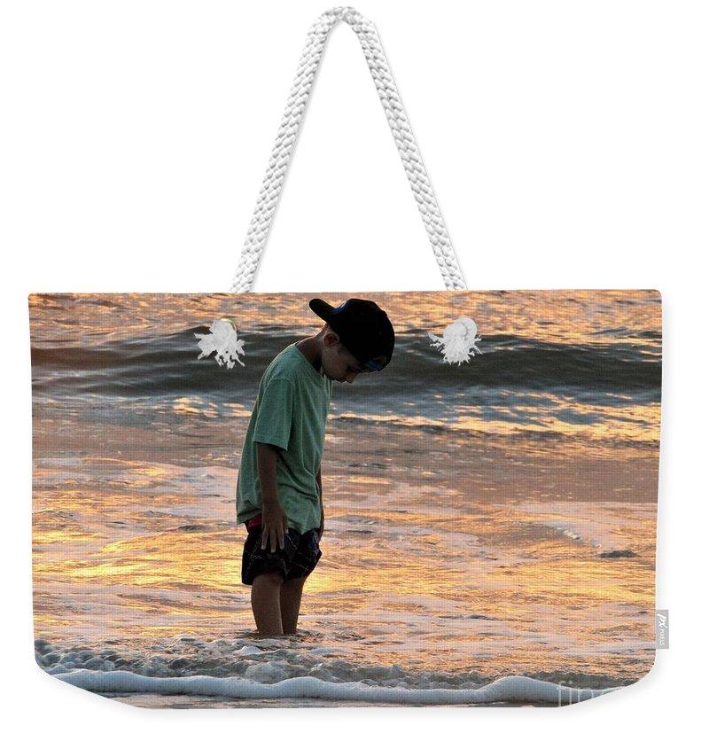 Sunrise On The Beach Weekender Tote Bag featuring the photograph Beach Boy by Judy Bugg Malinowski