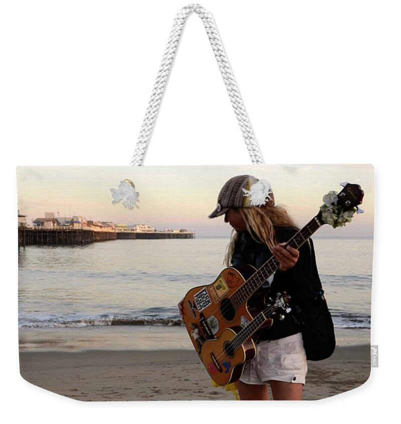Pier Weekender Tote Bag featuring the photograph Beach Musician by Bob Christopher