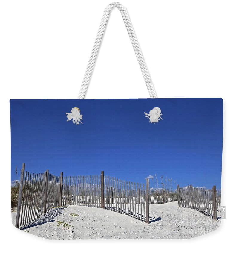 Beach Weekender Tote Bag featuring the photograph Beach Saver by John Stephens