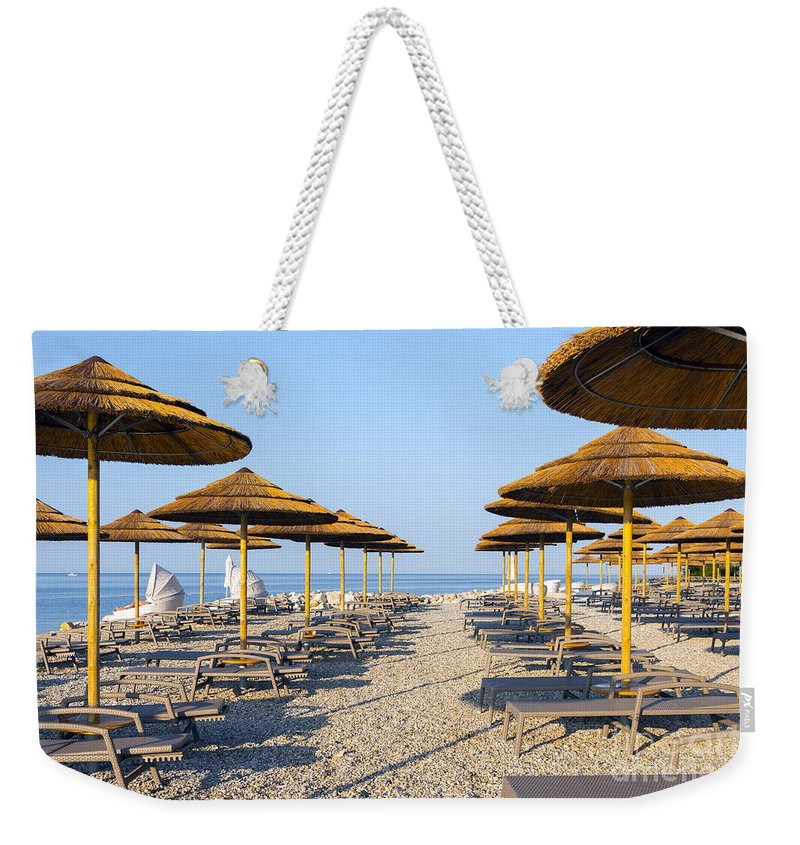 Bay Weekender Tote Bag featuring the photograph Beach Umbrellas by Svetlana Sewell