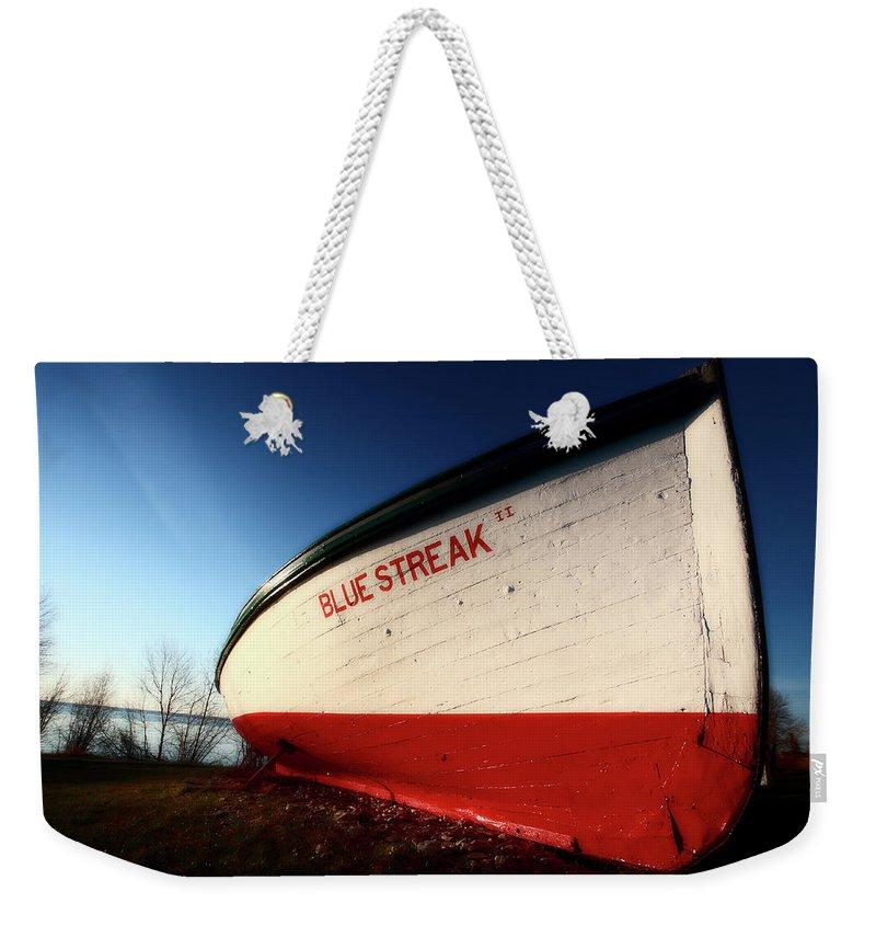 Fine Art Weekender Tote Bag featuring the digital art beached fishing boat at Hecla on Lake Winnipeg by Mark Duffy