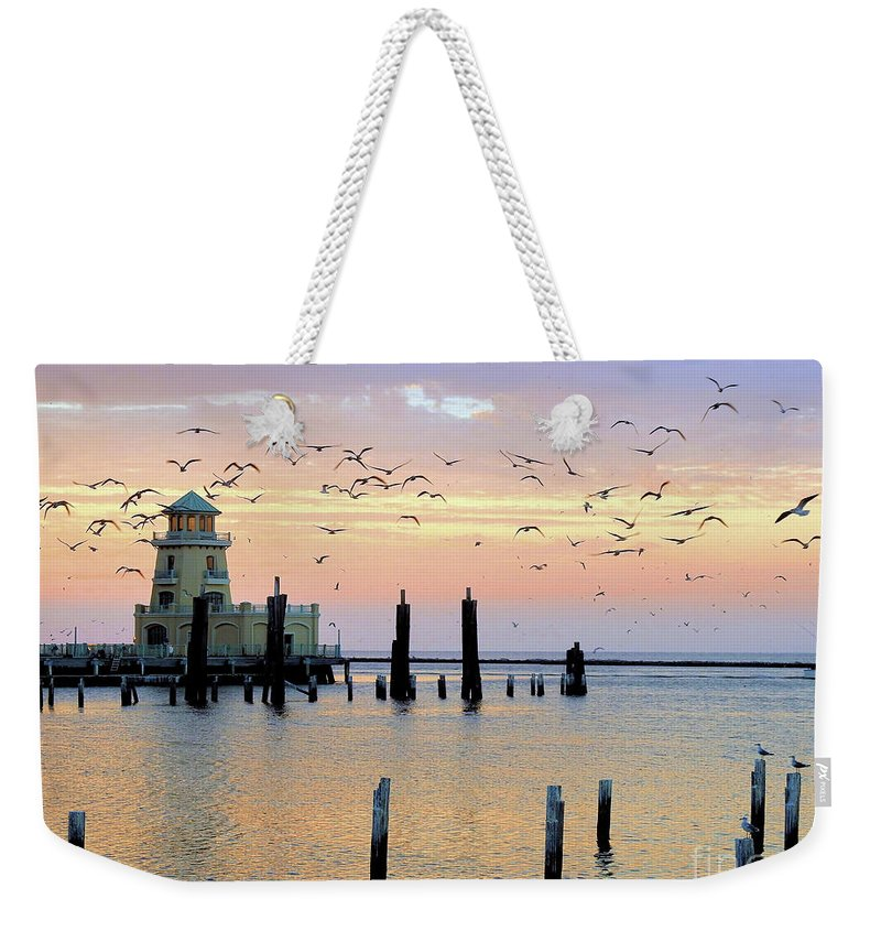 Marina-lighthouse-beau Rivage Weekender Tote Bag featuring the photograph Beau Rivage Marina And Lighthouse by Scott Cameron