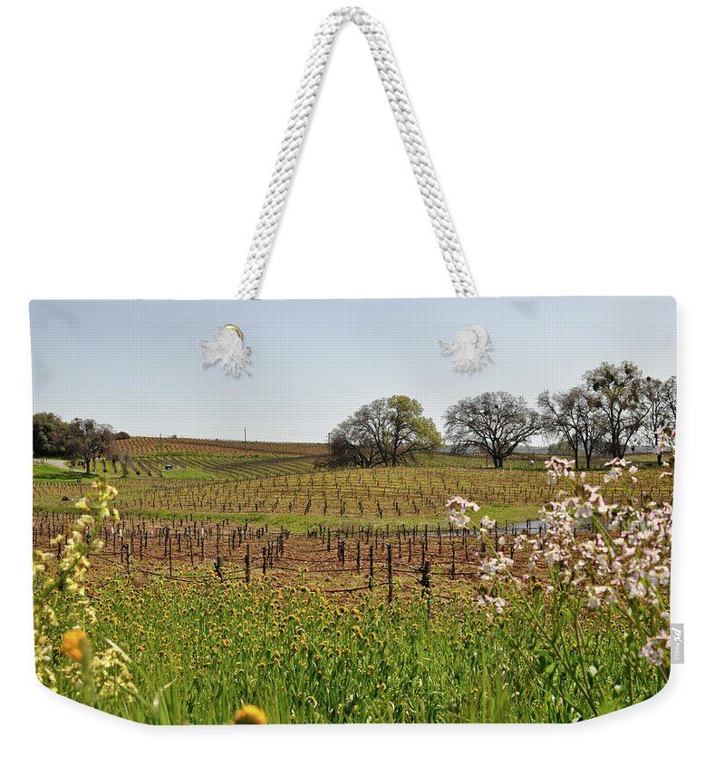 Green Weekender Tote Bag featuring the photograph Beautiful California Vineyard Framed With Flowers by Brandon Bourdages