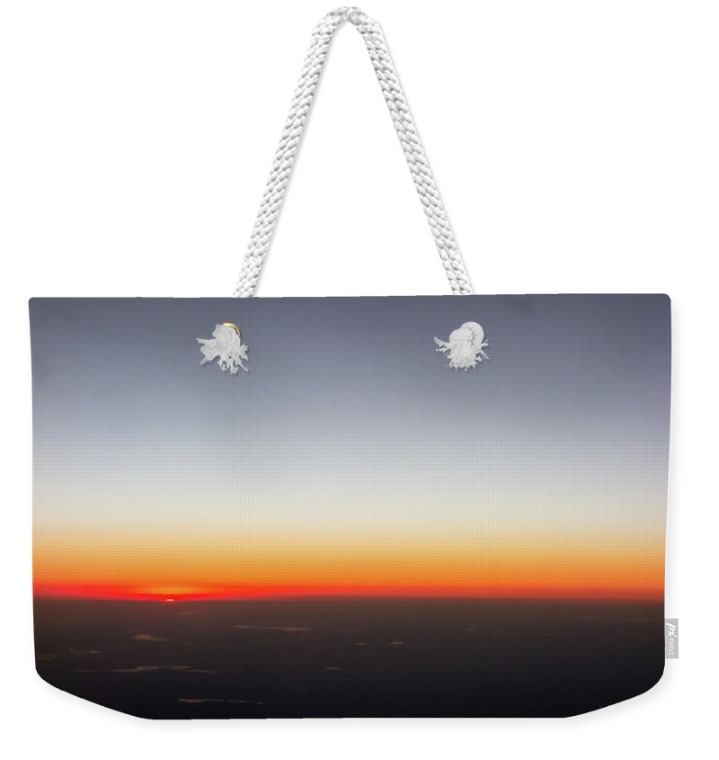 View Weekender Tote Bag featuring the photograph Beautiful Sunset View From An Airplane Over Land by Alex Grichenko