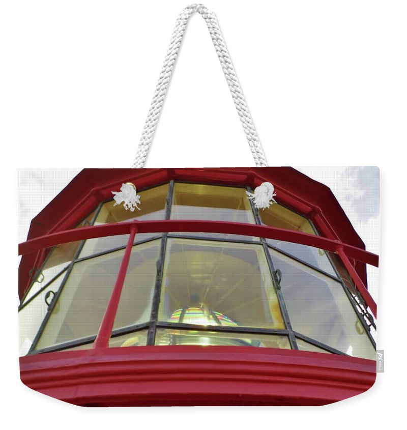 St Augustine Weekender Tote Bag featuring the photograph Beauty In The Lighthouse Lens by D Hackett