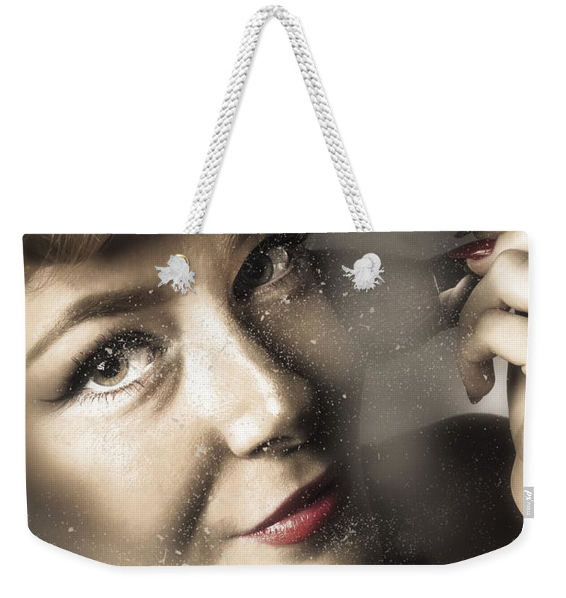 Makeup Weekender Tote Bag featuring the photograph Beauty Pin-up Woman Applying Makeup by Jorgo Photography - Wall Art Gallery