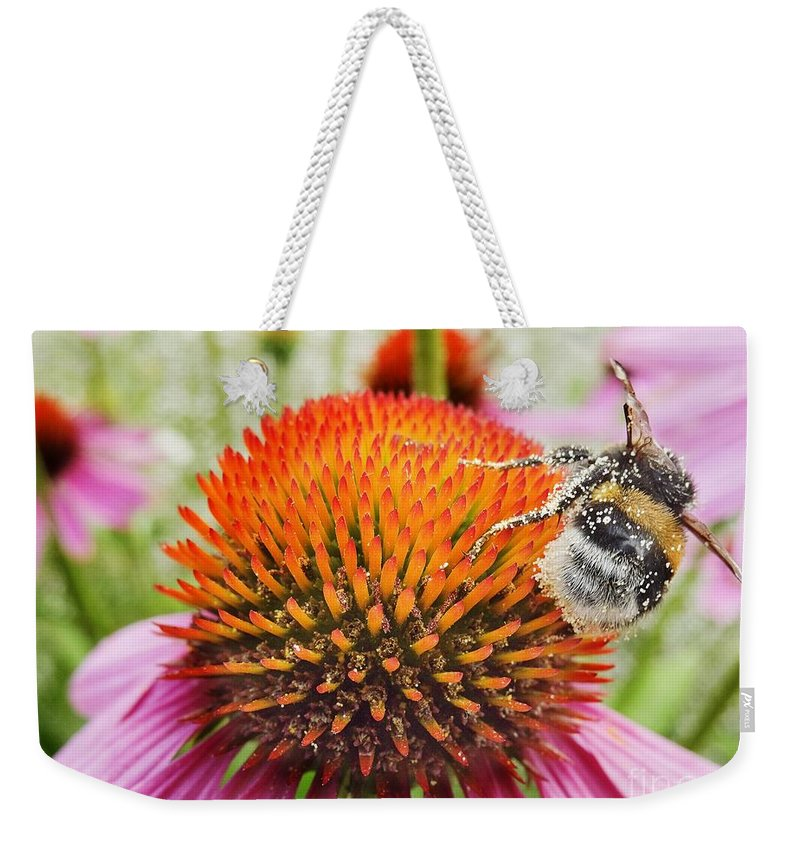 Air Weekender Tote Bag featuring the photograph Bee And Pink Flower by Vadzim Kandratsenkau