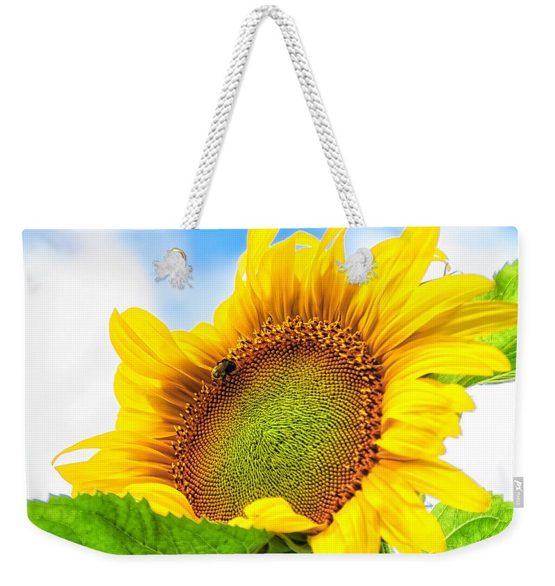 Michigan Weekender Tote Bag featuring the photograph Bee On Sunflower by Lars Lentz