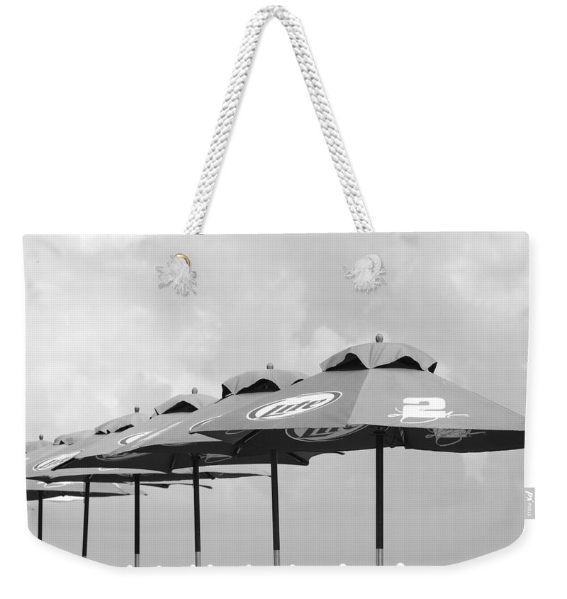 Black And White Weekender Tote Bag featuring the photograph Beer Unbrellas by Rob Hans
