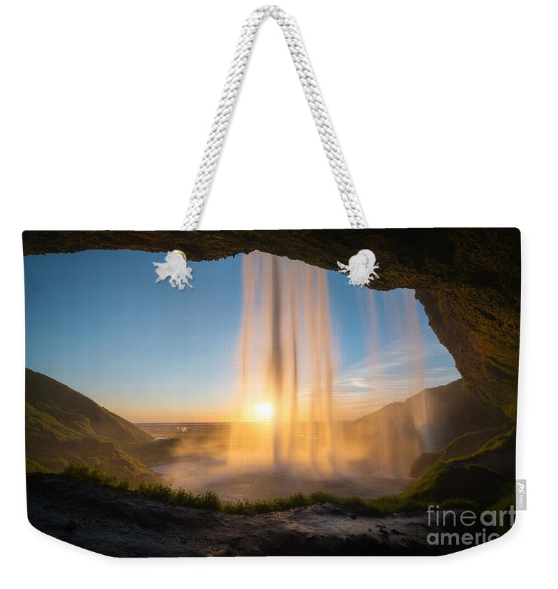 Iceland Weekender Tote Bag featuring the photograph Behind Seljalandsfoss Sunset by Michael Ver Sprill