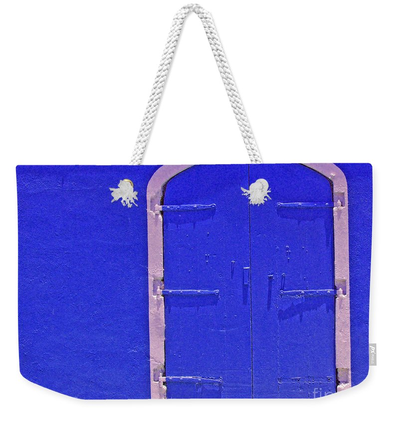 Door Weekender Tote Bag featuring the photograph Behind The Blue Door by Debbi Granruth