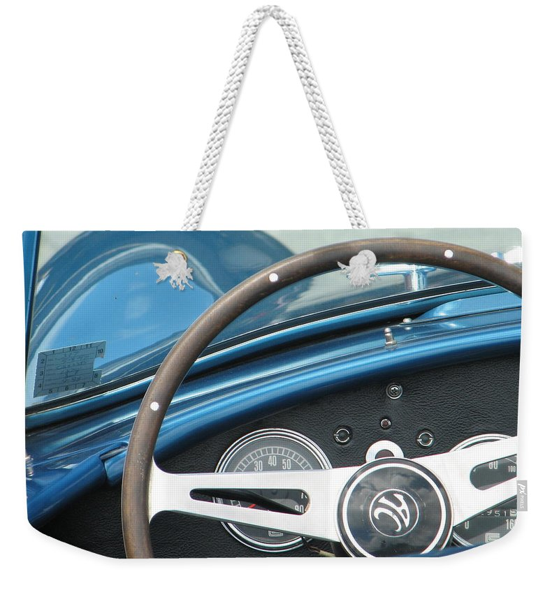 Cobra Weekender Tote Bag featuring the photograph Behind The Wheel by Kelly Mezzapelle