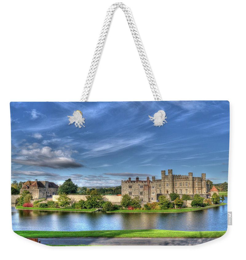 Leeds Castle Weekender Tote Bag featuring the photograph Bench View Of Leeds Castle by Chris Thaxter