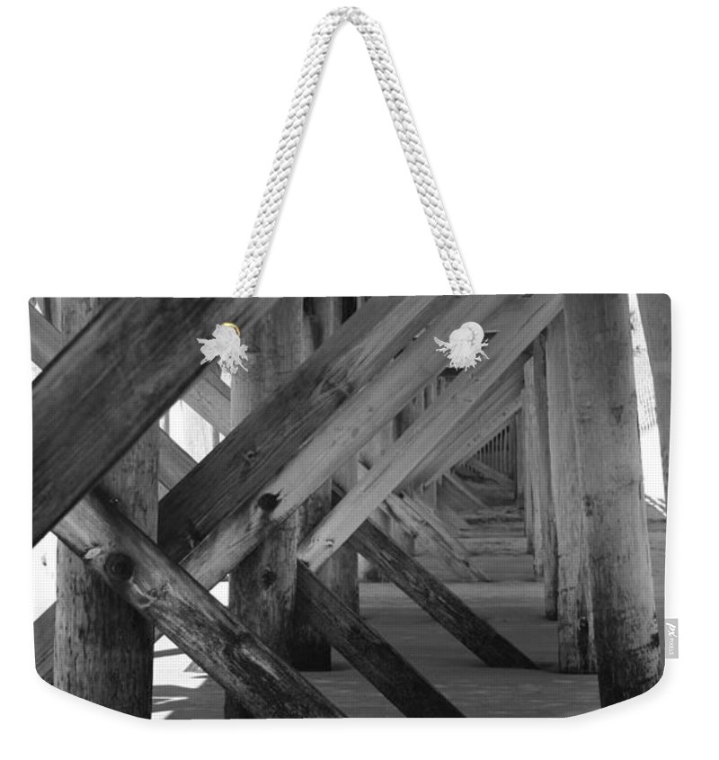 Weekender Tote Bag featuring the photograph Beneath The Docks Day by Jamie Lynn