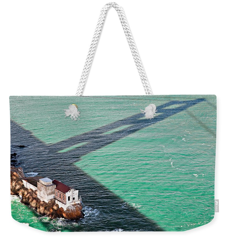 Golden Gate Bridge Weekender Tote Bag featuring the photograph Beneath The Golden Gate by Dave Bowman