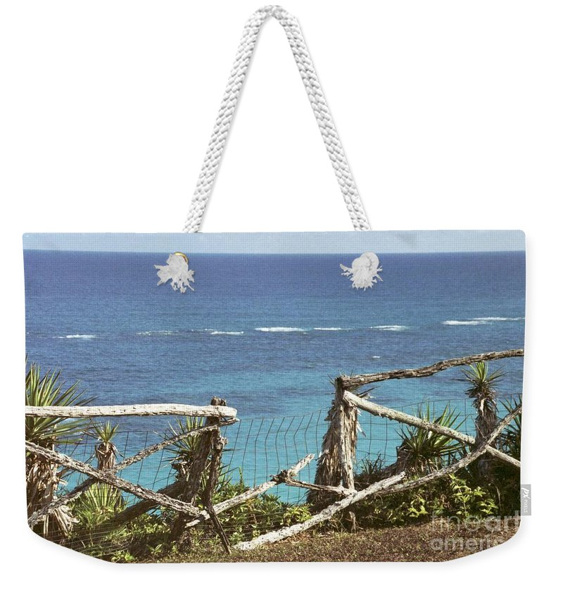Bermuda Weekender Tote Bag featuring the photograph Bermuda Fence And Ocean Overlook by Heather Kirk