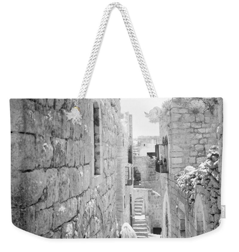 Bethlehem Weekender Tote Bag featuring the photograph Bethlehem - Old Woman Walking 1933 by Munir Alawi