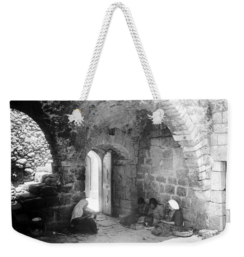 Bethlehem Weekender Tote Bag featuring the photograph Bethlehemites Women Working Year 1925 by Munir Alawi