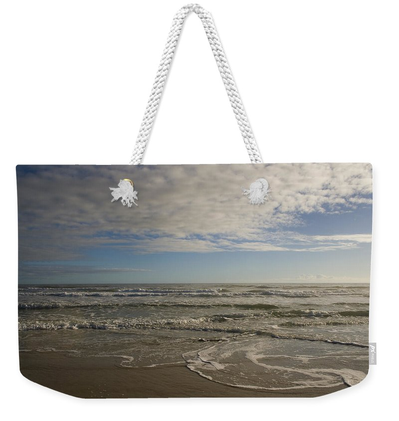 Wave Sand Ocean Beach Sky Water Wave Tide Sun Sunny Vacation Cloud Morning Early Weekender Tote Bag featuring the photograph Between Night And Day by Andrei Shliakhau